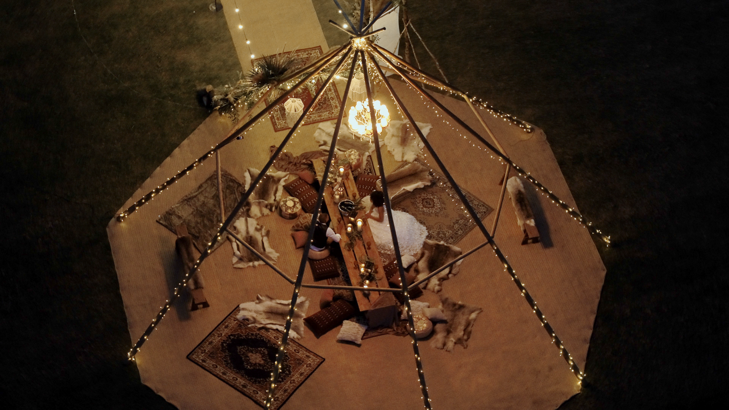 aerial photograph of wedding couple in teepee