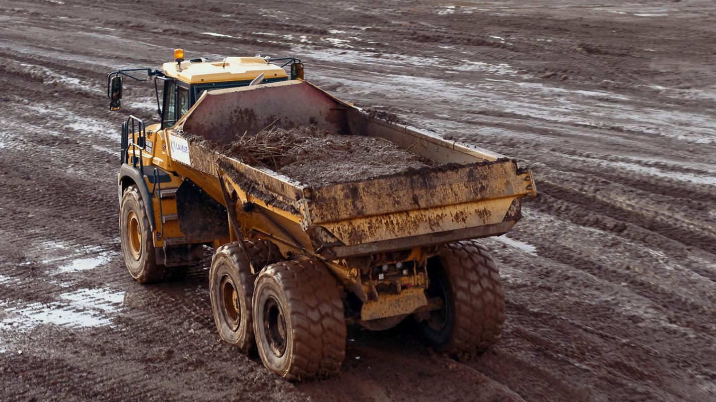 hauler carrying mud